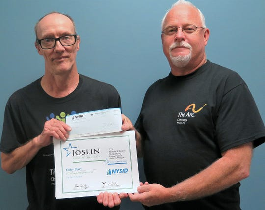 Southern Tier Industries custodian Coley Perry, left, shows off his Joslin Outstanding Performers award along with mobile work crew manager Tom Harrigan.