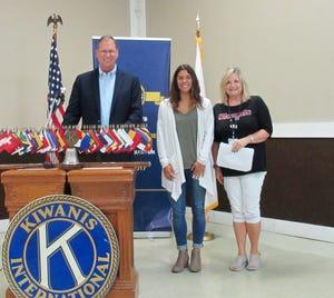 Kiwanis Division 12 Lt. Governor Steve Pitzer, left   stands with Gibsonburg Key Club President Jessica Davies, and Fremont Kiwanis President Beth Rice.