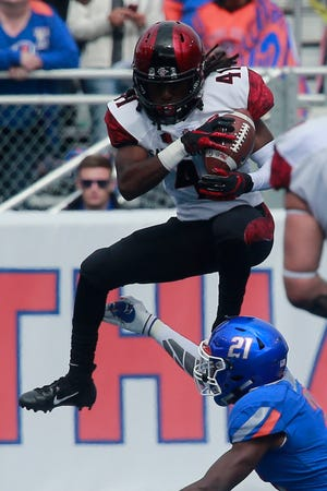 San Diego State receiver B.J. Busbee leaps over Boise State safety Tyreque Jones during the Aztecs' 19-13 win Saturday over the Broncos at Albertsons Stadium in Boise, Idaho. San Diego State jumped over Boise State and into the top spot in our weekly Mountain West power ratings with the victory.