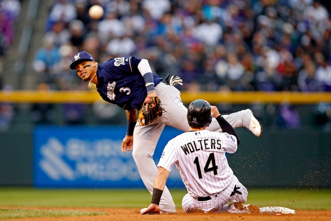 Oct 7, 2018; Denver, CO, USA; Milwaukee Brewers shortstop Orlando Arcia (3) forces out Colorado Rockies catcher Tony Wolters (14) at second base but can not turn a double play during the fifth inning in game three of the 2018 NLDS playoff baseball series at Coors Field. Mandatory Credit: Russell Lansford-USA TODAY Sports