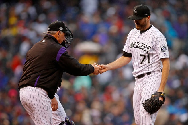 Oct 7, 2018; Denver, CO, USA; Colorado Rockies manager Bud Black (10) removes relief pitcher Wade Davis (71) from the game during the ninth inning against the Milwaukee Brewers in game three of the 2018 NLDS playoff baseball series at Coors Field. Mandatory Credit: Russell Lansford-USA TODAY Sports