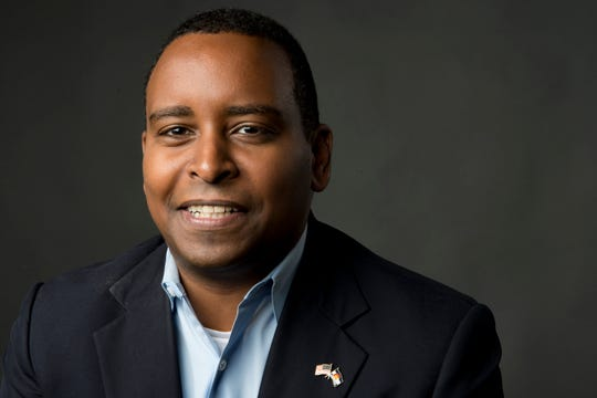 Colorado's 2nd Congressional District democratic candidate Joe Neguse poses for a photo in the Coloradoan newsroom on Monday, October 8, 2018.