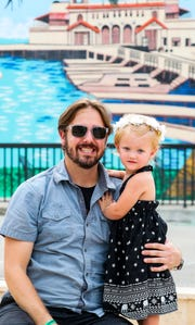 Shaun Miller and his daughter Rylee in Downtown Fort Myers. Miller is a member in the band Faded Roots and they wrote a song called Toxic Mentality, inspired by the water crisis in Southwest Florida.