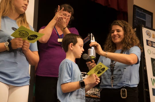 Allen Park Elementary School student, Oren Philpott askes a question of International Space Station astronaut Serena Aunon-Chancellor on Monday.