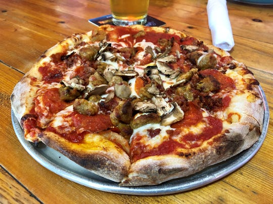 Great White Grill on Sanibel is known for its hand-tossed pizzas and long list of beers.
