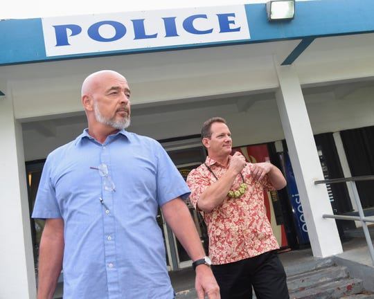Lt. Gov Ray Tenorio, right, exits Guam Police Department Hagåtña precinct after he was booked in his gun-grabbing case on Oct. 8, 2018. Tenorio was accompanied by his attorney Tom Fisher, left.