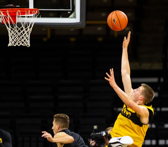 Iowa guard Joe Wieskamp (10) shoots over Iowa guard Jordan Bohannon (3) during men's basketball practice following media day on Monday, Oct. 8, 2018, at Carver-Hawkeye Arena in Iowa City.