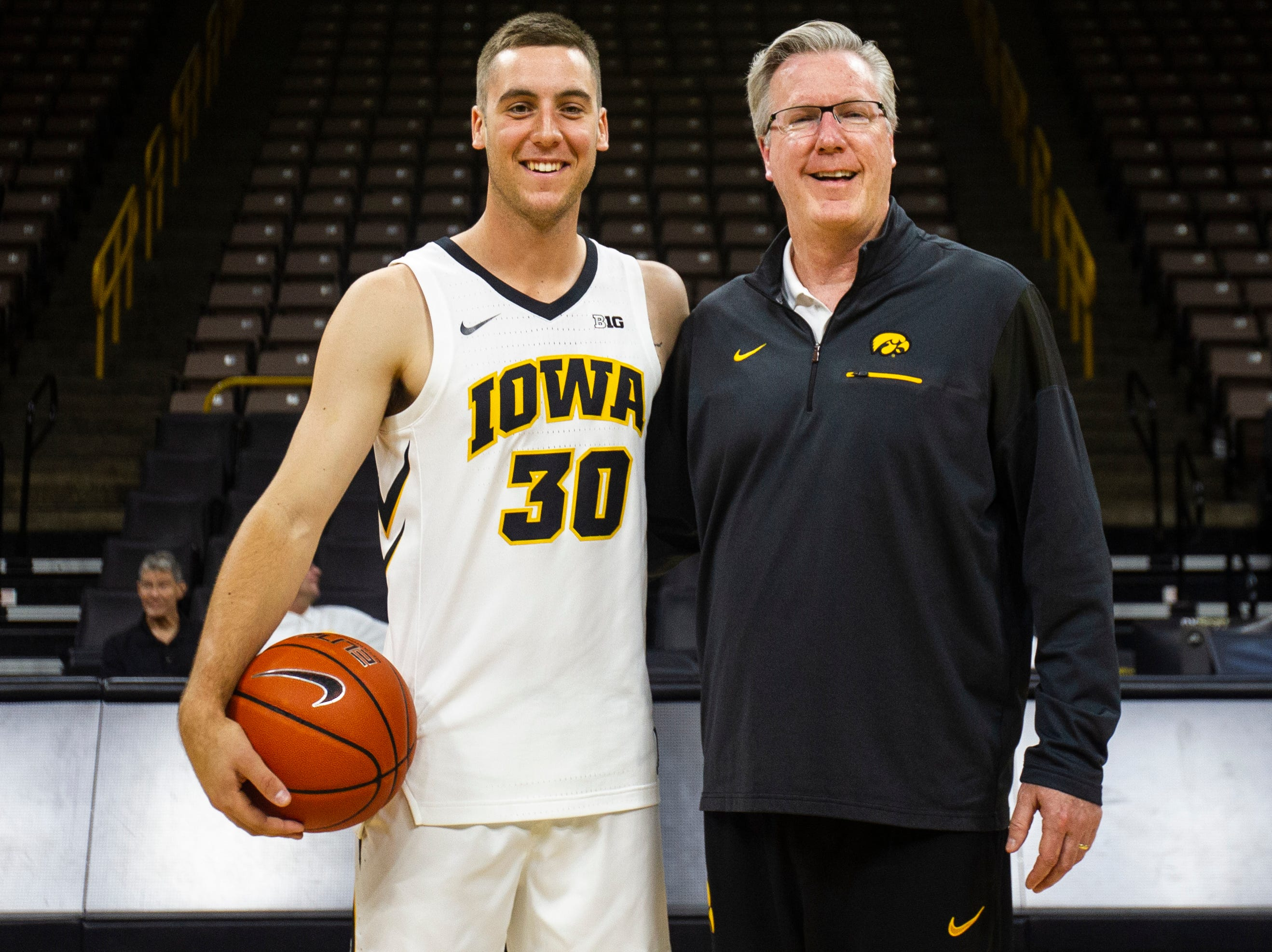 Iowa guard Connor McCaffery stands with his father Iowa men's basketball head coach Fran McCaffery for a photo during Iowa men's basketball media day on Monday, Oct. 8, 2018, at Carver-Hawkeye Arena in Iowa City.