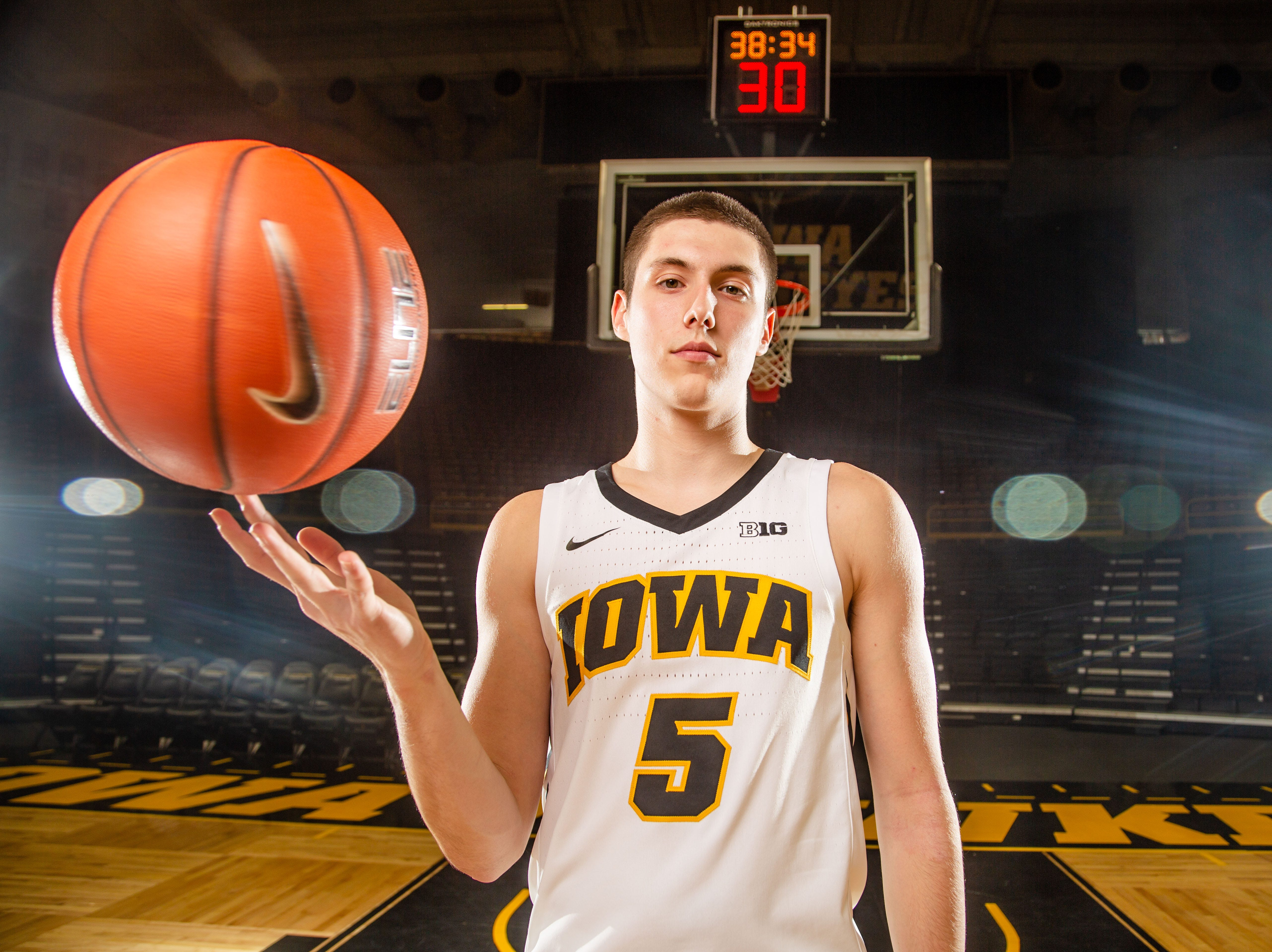 Iowa guard C.J. Fredrick poses for a photo during Hawkeye media day at Carver Hawkeye ArenaMonday, Oct. 8, 2018.