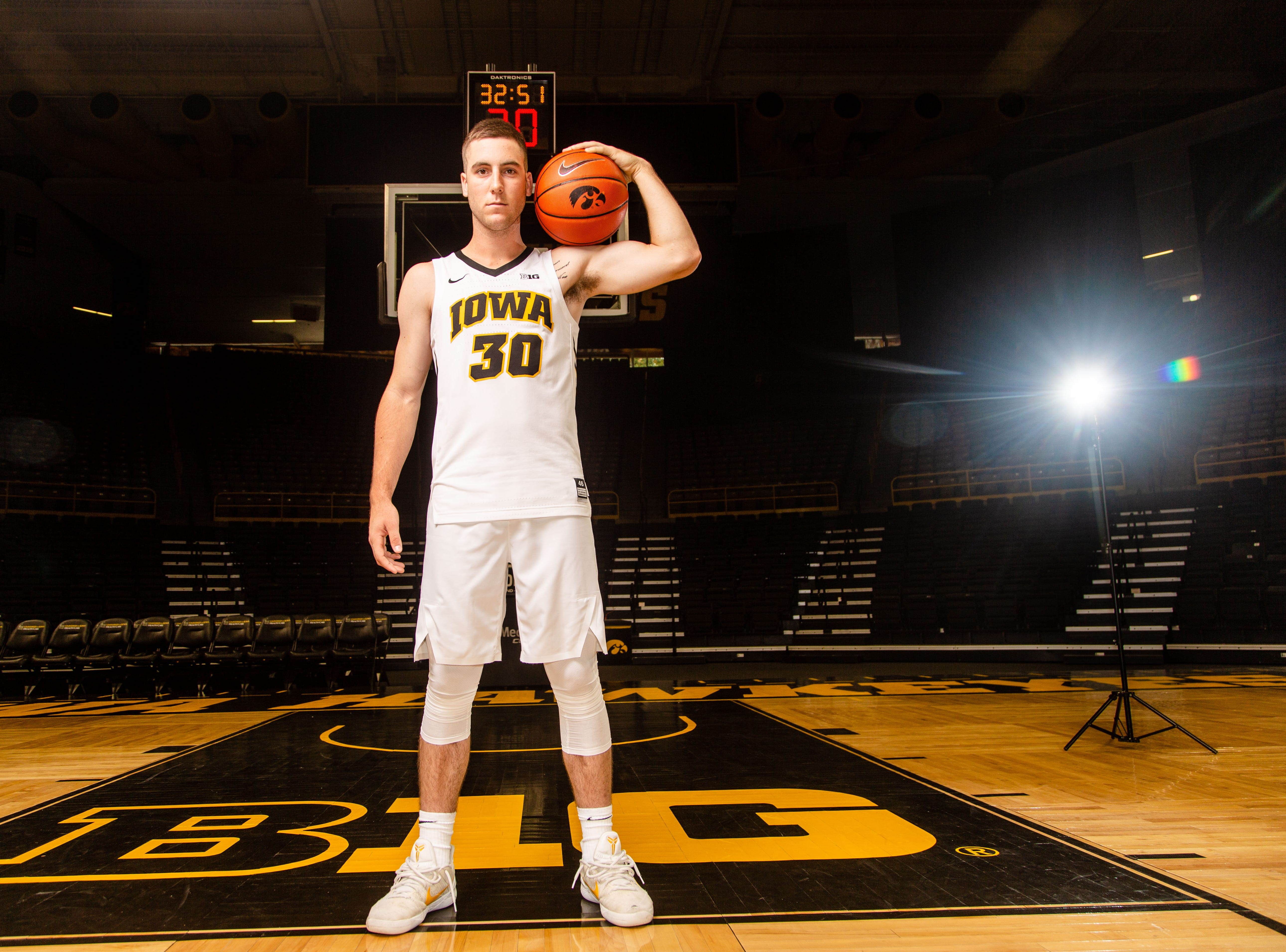 Iowa guard Connor McCaffery poses for a photo during Hawkeye media day at Carver Hawkeye ArenaMonday, Oct. 8, 2018.