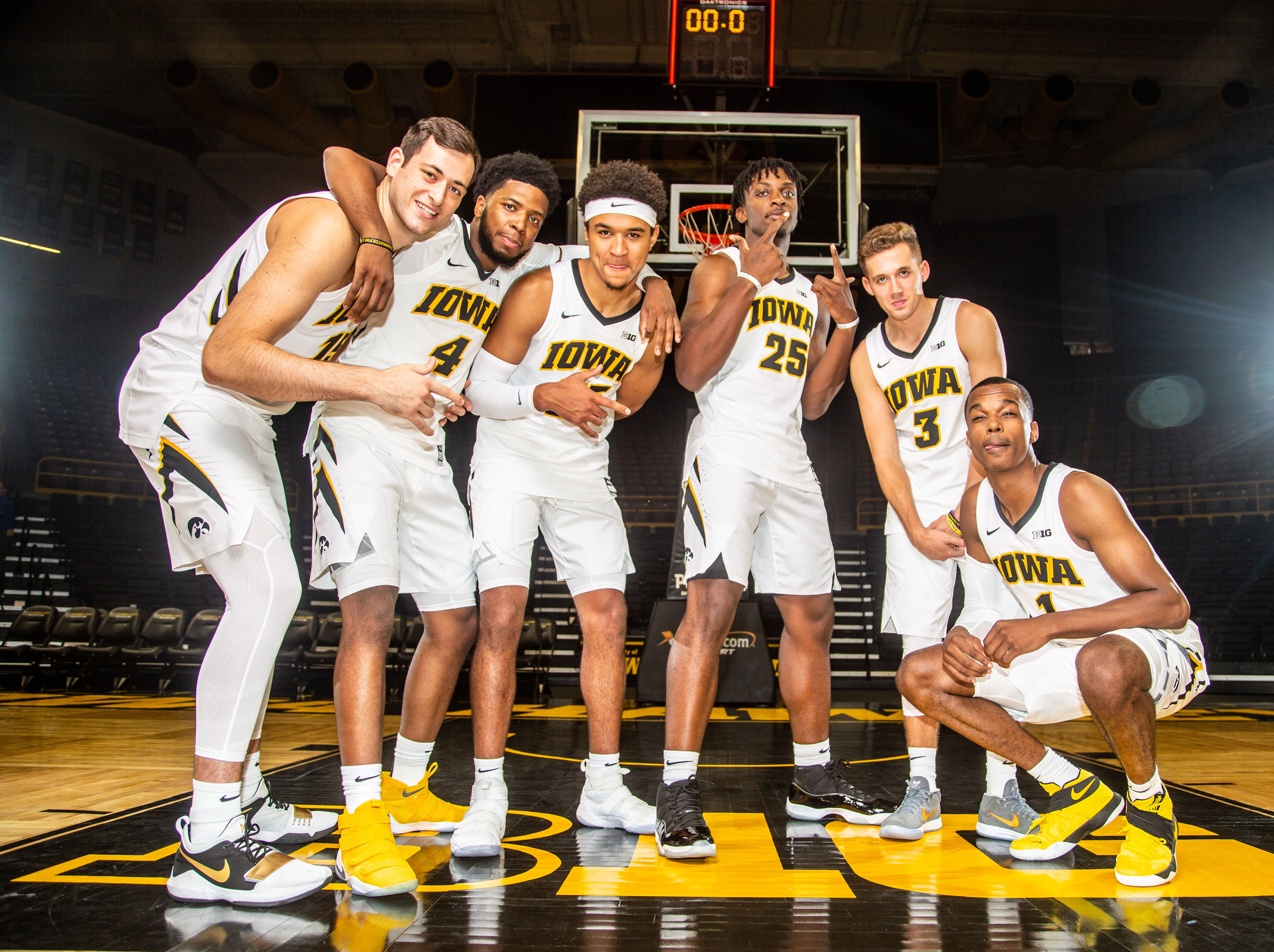 Iowa Juniors Ryan Kriener, Isaiah Moss, Cordell Pemsl, Tyler Cook, Jordan Bohannon, and Maishe Dailey pose for a photo during Hawkeye media day at Carver Hawkeye ArenaMonday, Oct. 8, 2018.