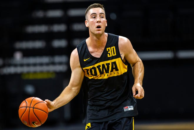 Iowa guard Connor McCaffery (30) runs a drill during men's basketball practice following media day on Monday, Oct. 8, 2018, at Carver-Hawkeye Arena in Iowa City.