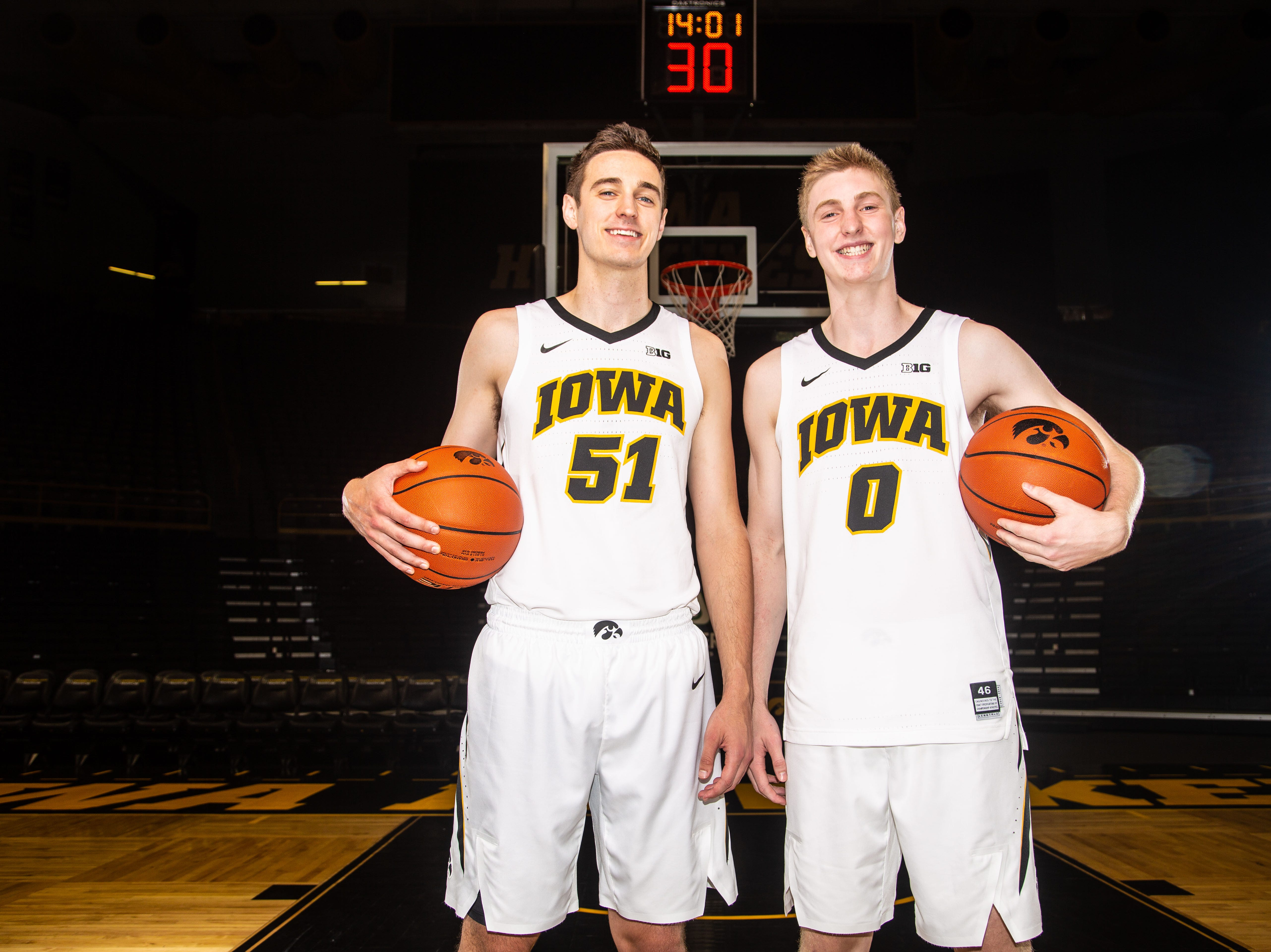 Iowa forward Nicholas Baer poses with his brother Iowa forward Michael Baer during Hawkeye media day at Carver Hawkeye ArenaMonday, Oct. 8, 2018.