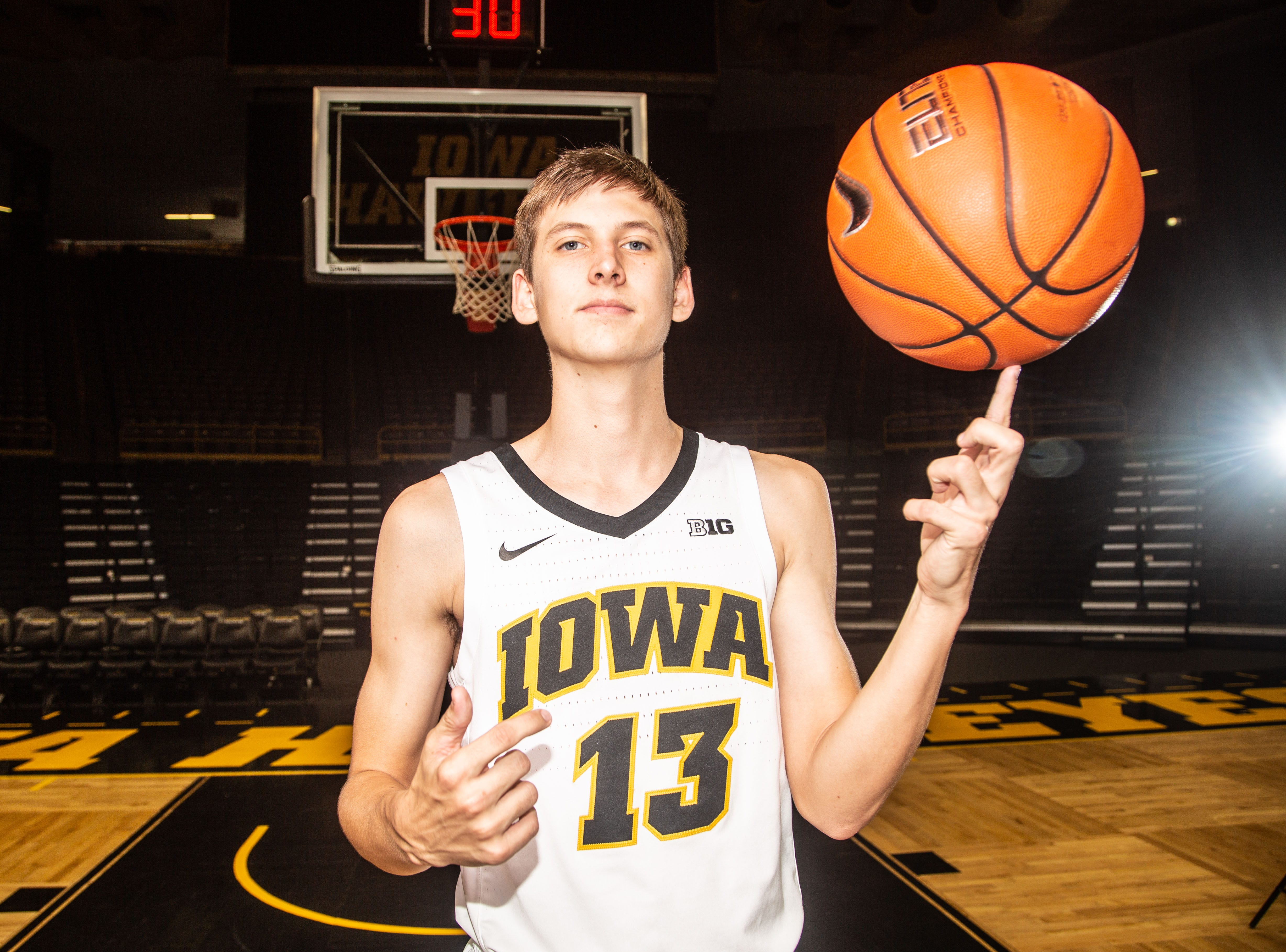 Iowa guard Austin Ash poses for a photo during Hawkeye media day at Carver Hawkeye ArenaMonday, Oct. 8, 2018.