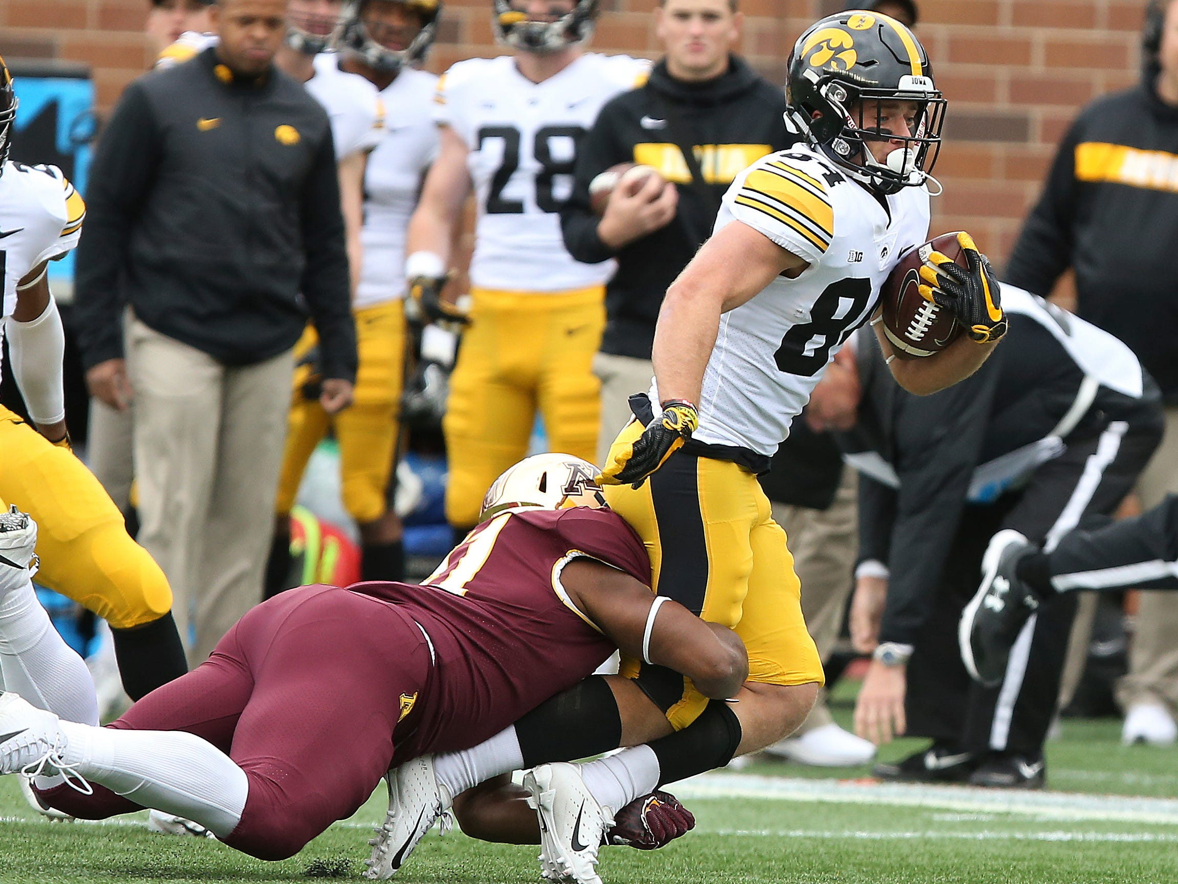 Iowa wide receiver Nick Easley controls the ball against Minnesota's Thomas Barber during an NCAA college football game Saturday, Oct. 6, 2018, in Minneapolis. (AP Photo/Stacy Bengs)