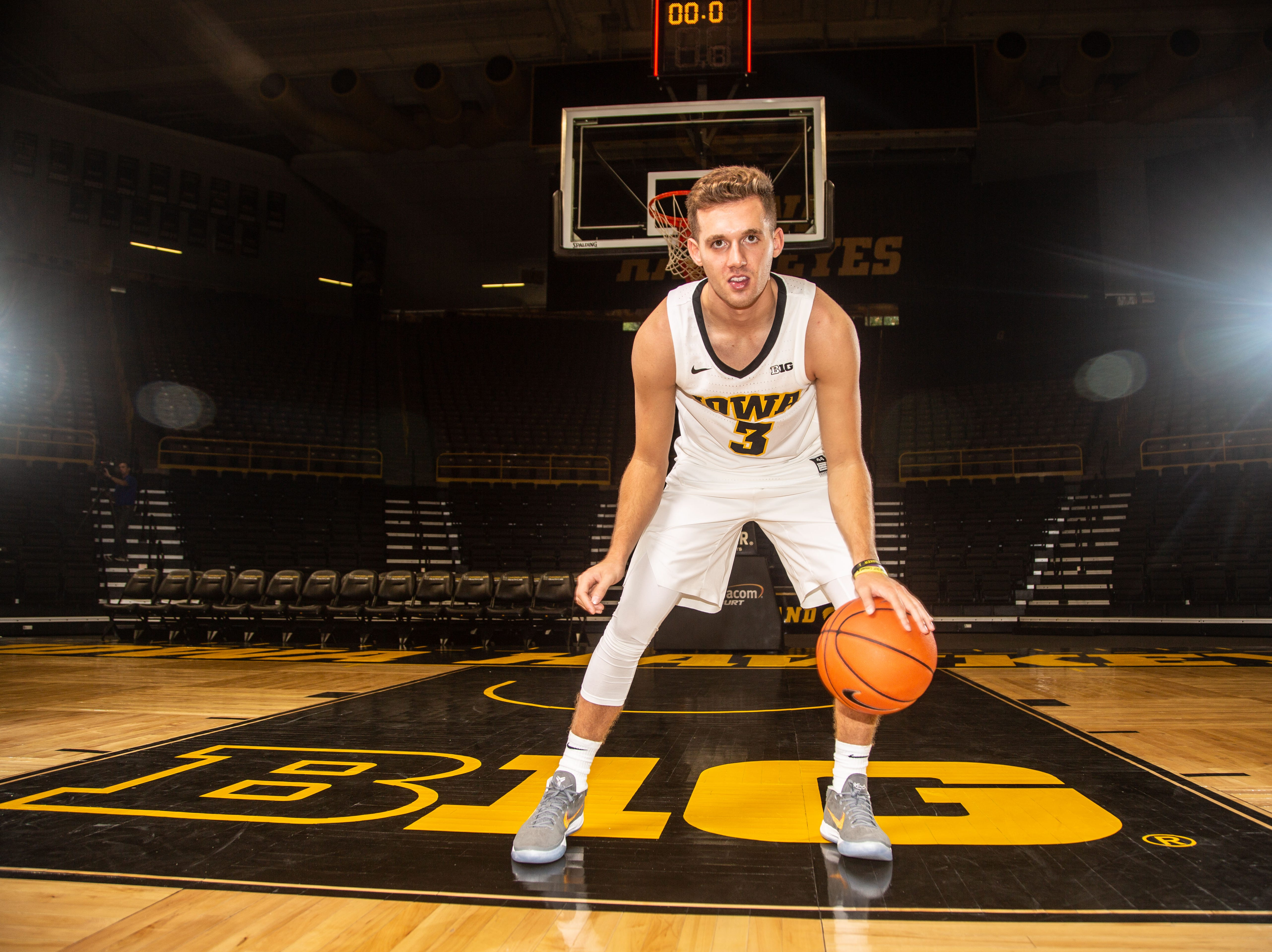 Iowa guard Jordan Bohannon poses for a photo during Hawkeye media day at Carver Hawkeye ArenaMonday, Oct. 8, 2018.
