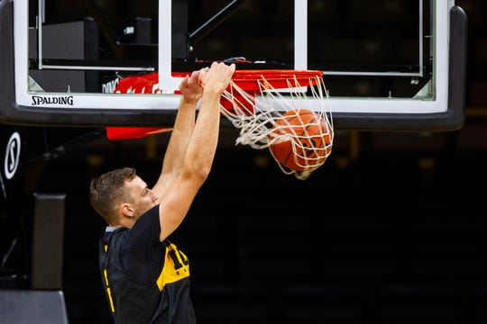 Iowa forward Jack Nunge (2) dunks during men's basketball practice following media day on Monday, Oct. 8, 2018, at Carver-Hawkeye Arena in Iowa City.