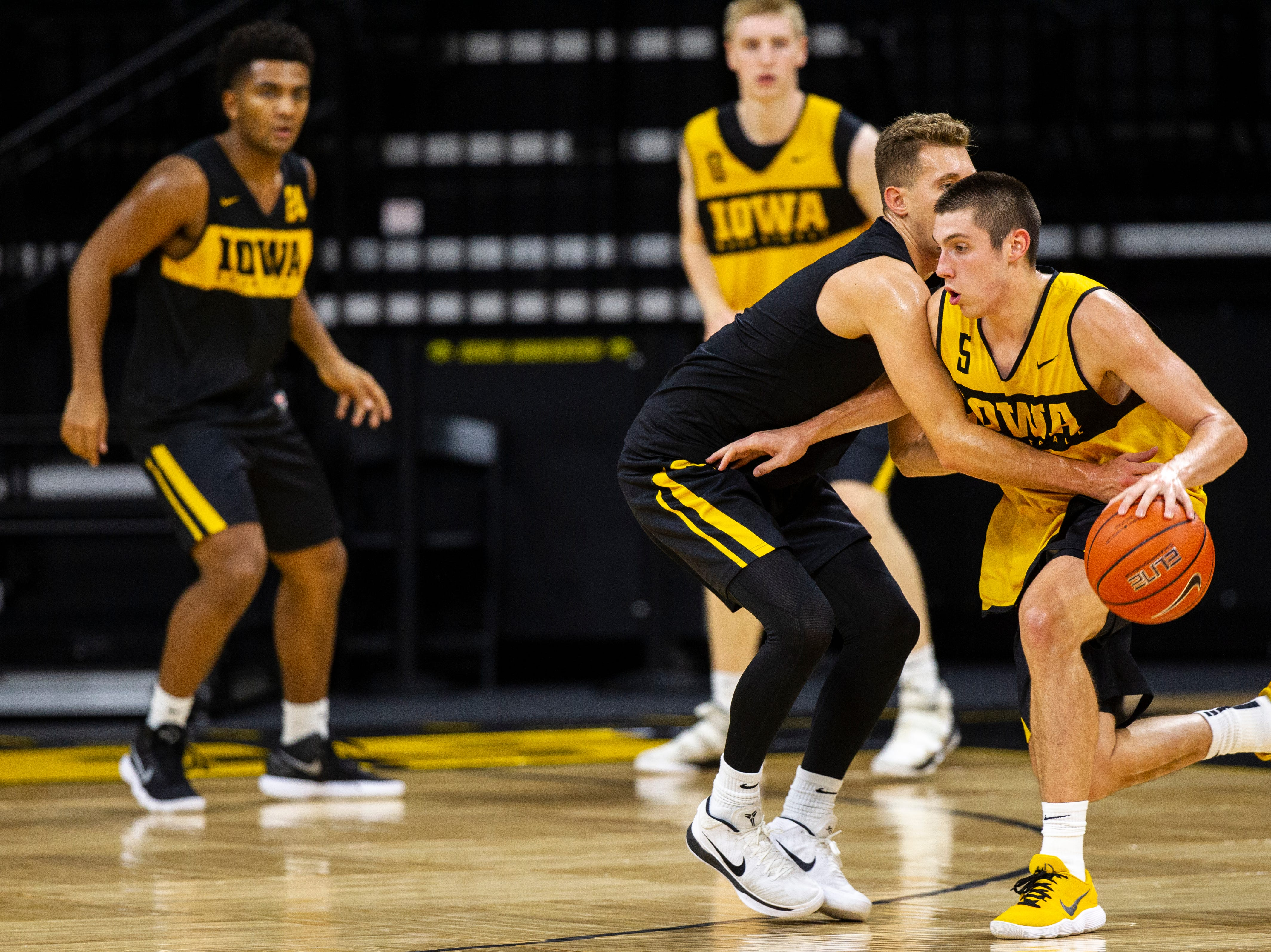 Iowa guard C.J. Fredrick (5) tries to get past Iowa guard Jordan Bohannon (3) during men's basketball practice following media day on Monday, Oct. 8, 2018, at Carver-Hawkeye Arena in Iowa City.