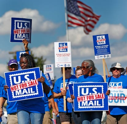 Postal Workers And Supporters March In Support Of Keeping The Postal Service From Privatization