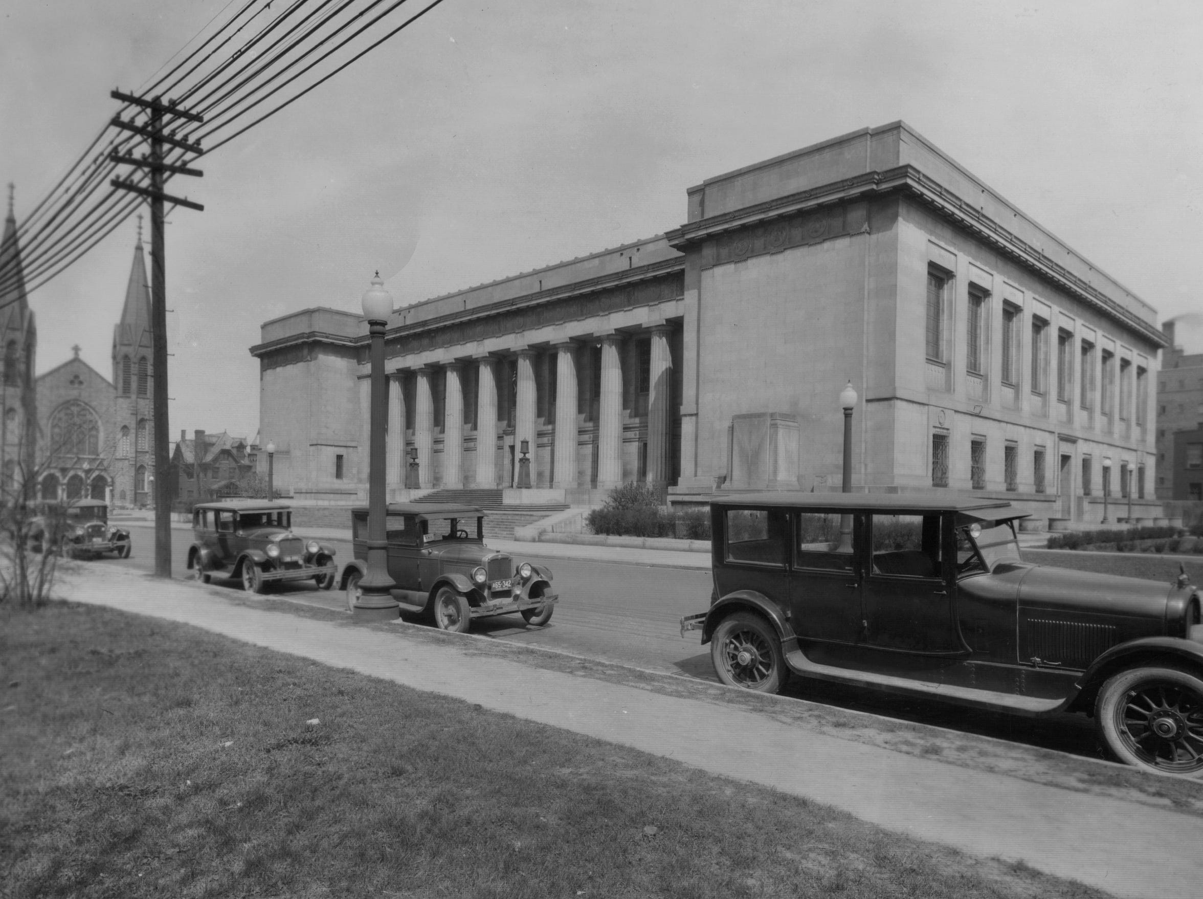 1928 photo of the Indianapolis Central Library  on land donated by James Whitcomb Riley at St. Clair between Pennsylvania and Meridian Streets.The building was designed by Philadelphia architect Paul Cret, and was designed in a Greek Doric style fashion and constructed of Indiana limestone.