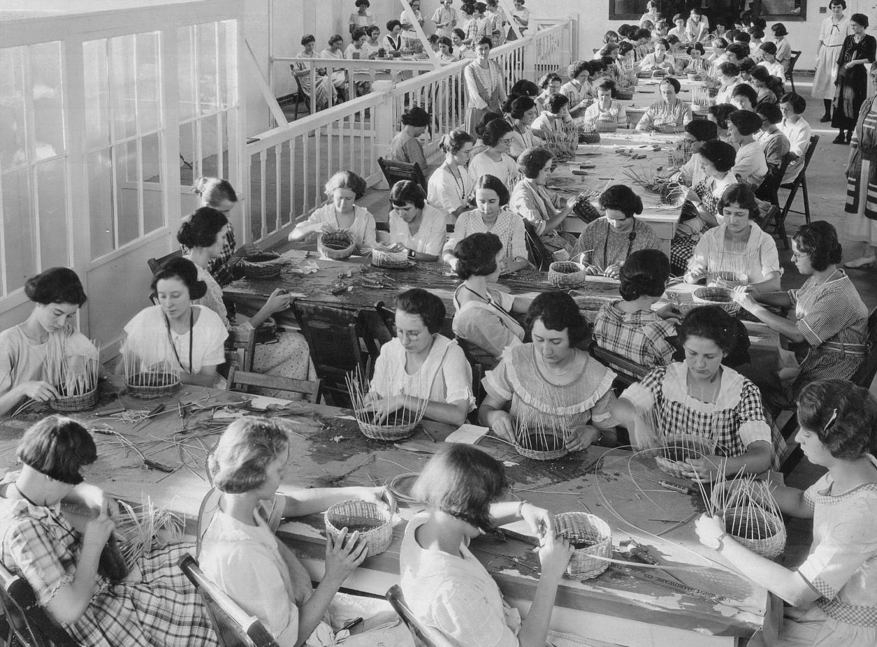 The girls' school of home economics demonstrated the art of basket making at the 1927 Indiana State Fair.
