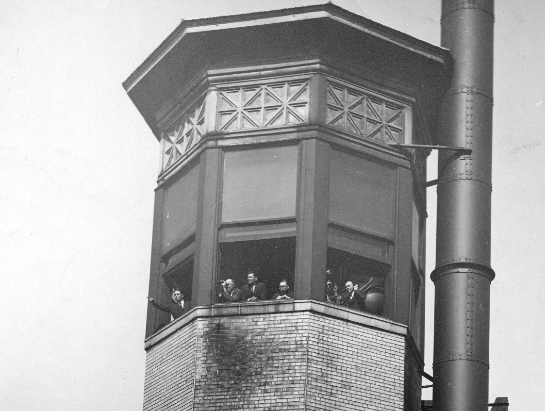 Indianapolis Fire Tower - members of the Smoke Abatement League watch from the fire tower on the Merchants Bank building.  The league kept watch on pollution production in the city.  1929 file photo