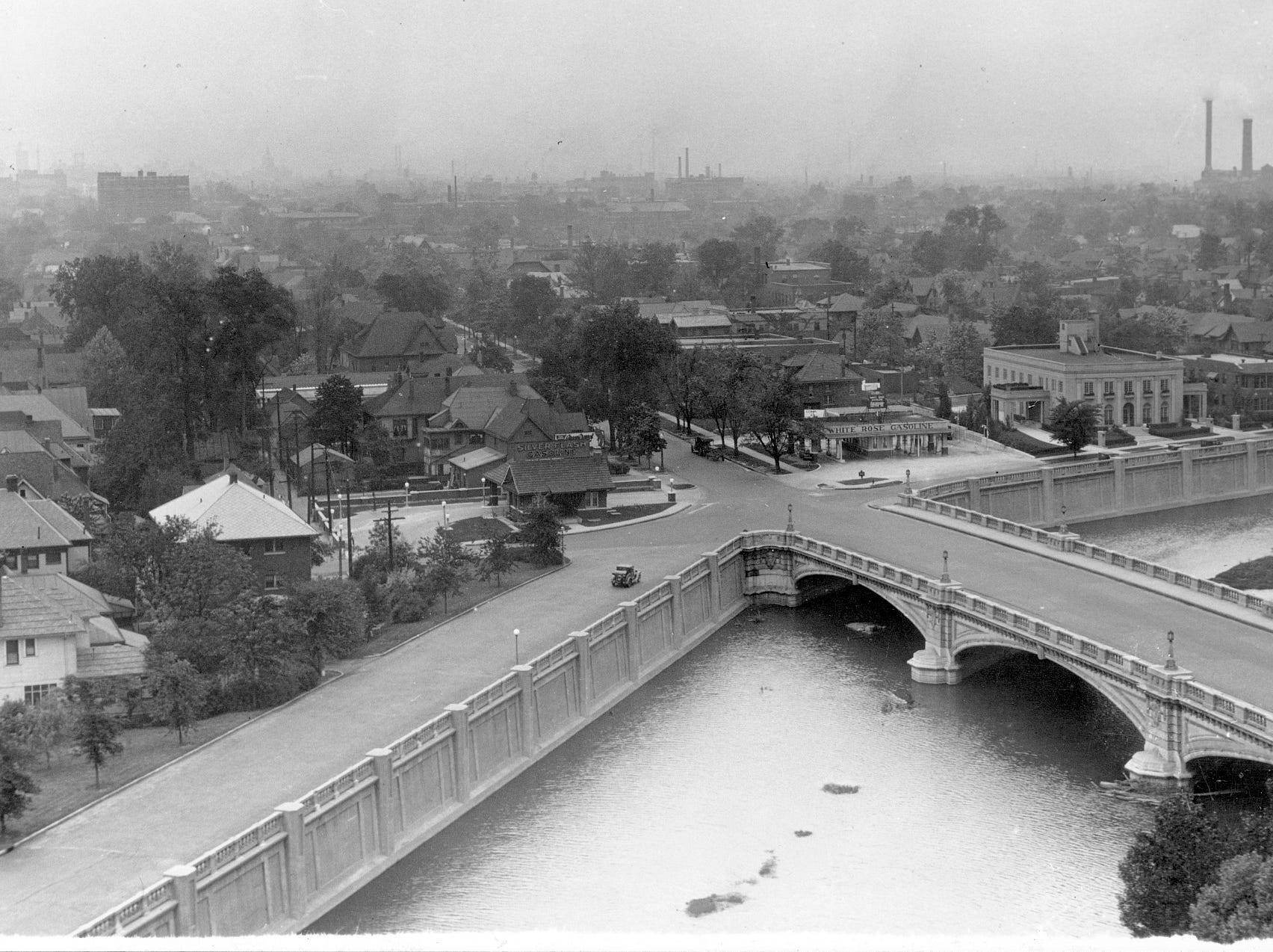 Concrete walls contain Fall Creek as it flows underneath the Meridian Street bridge in this view looking southwest towards downtown on May 28, 1928. In those days, this stretch of Meridian Street was a residential neighborhood graced with beautiful trees and inviting sidewalks.