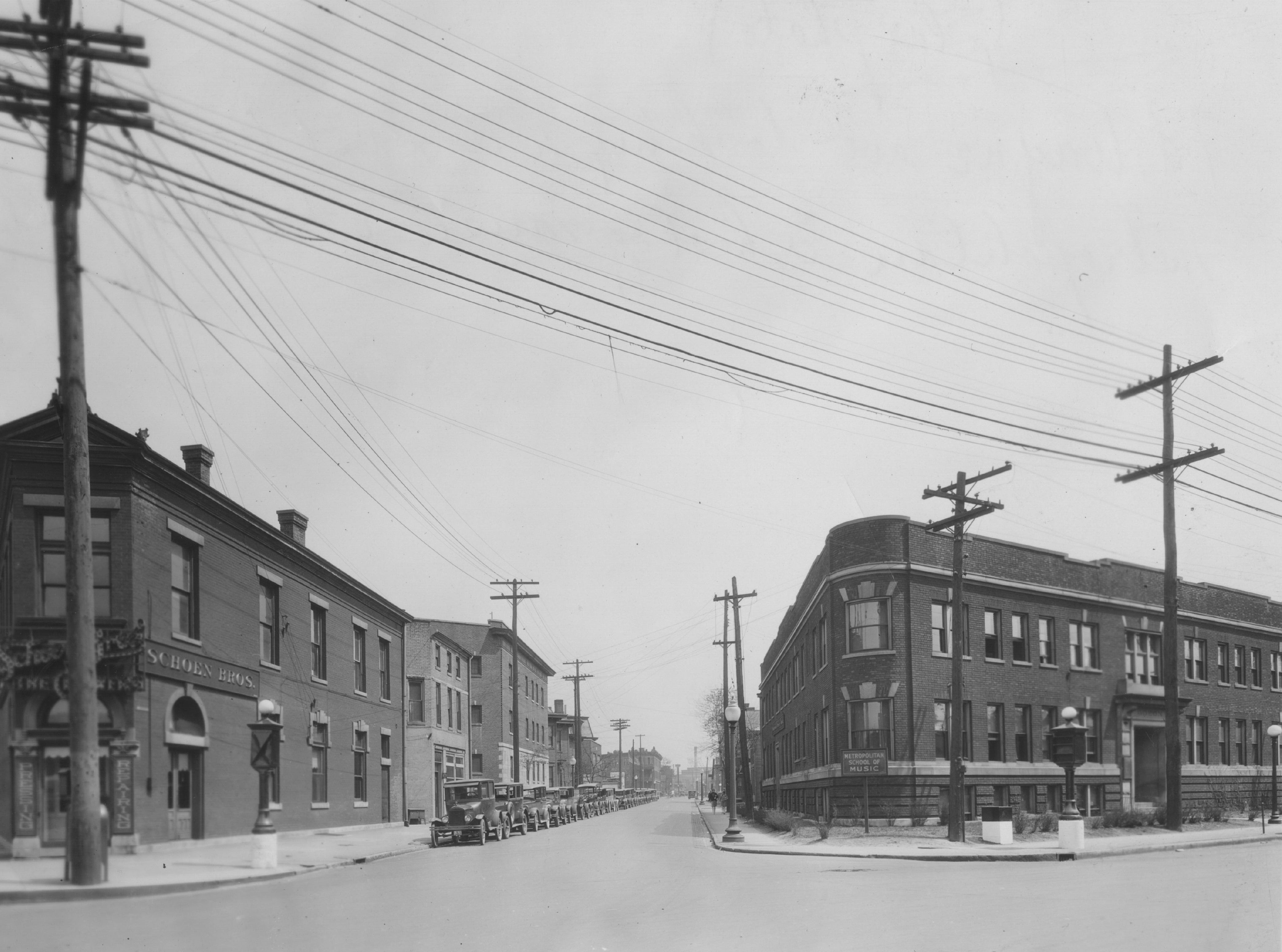 Ft Wayne Avenue looking northeast from North St. Jan 1, 1929.  The Metropolitan School of Museum and Odean Hall is at the right (this later became the Arthur Jordan Conservatory) This is now a parking lot.  The building at the left is Schoen Bros. Cleaners.