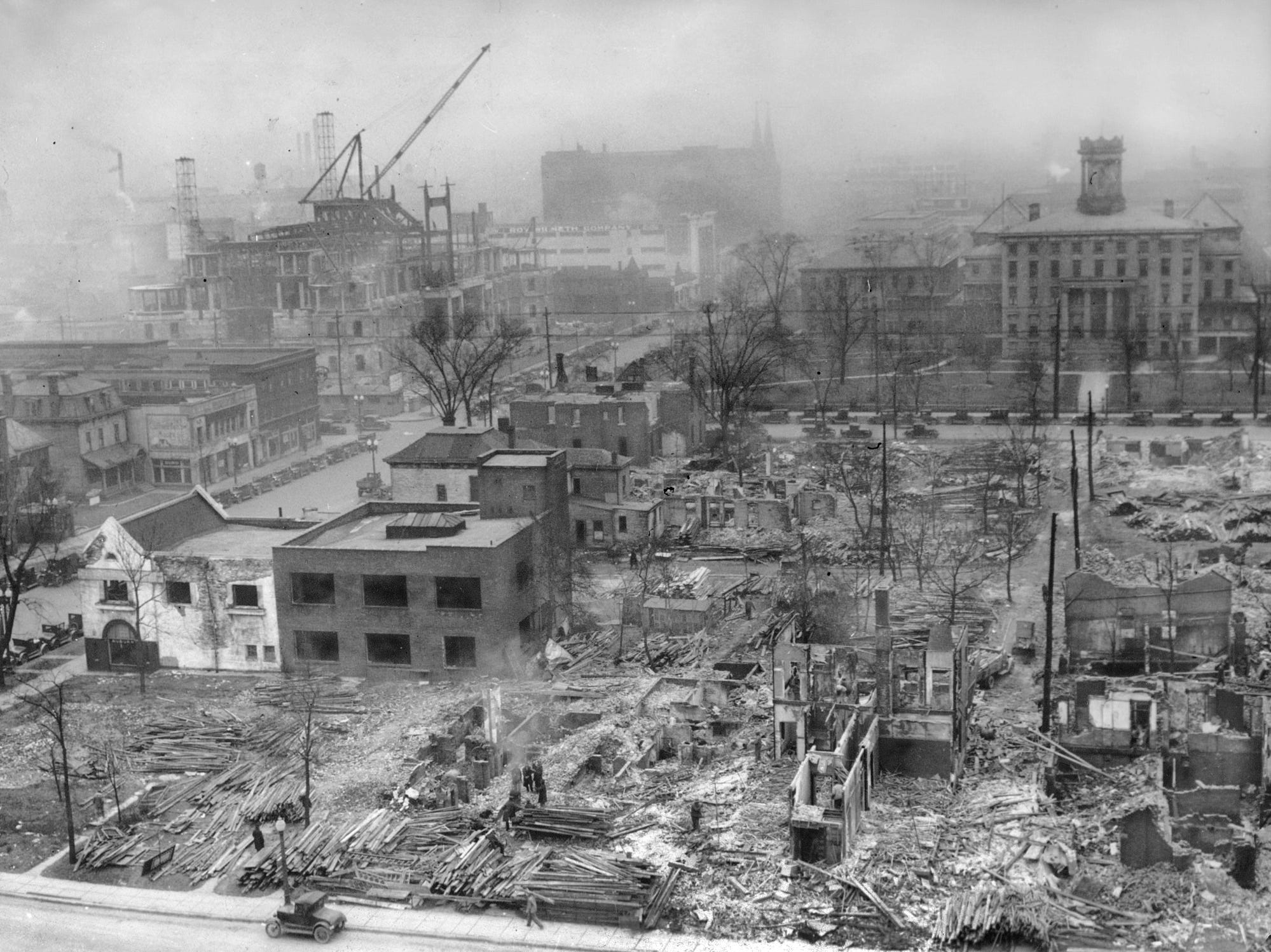 The demolition of buildings on the east side of Meridian Street looking north from Michigan Street made way for Veteran's Memorial Plaza, under construction in Downtown Indianapolis on Feb. 11, 1928. The old Indiana School for the Blind, shown in the background at right (facing North Street), eventually met a similar fate years later. This area became part of a five-block civic plaza from New York Street on the south to St. Clair Street on the north, incorporating University Park, the Indiana World War Memorial, Obelisk Square and the American Legion Mall. Work on the World War Memorial, on the south side of Michigan Street, began early in 1926. The block shown here is now Obelisk Square, completed in 1930, featuring a 100-foot-tall pillar faced in granite and surrounded by a fountain.