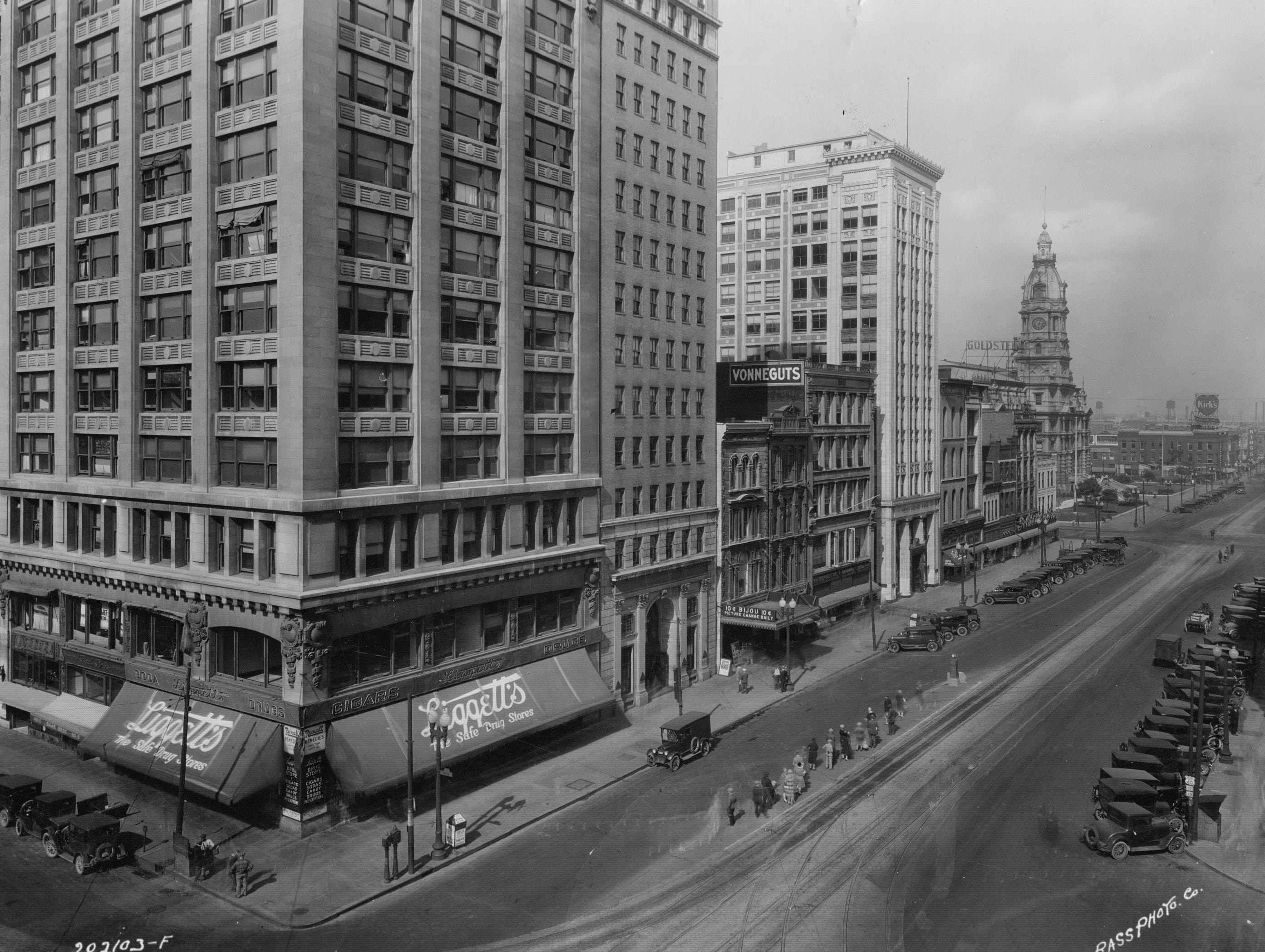 "Northeast corner of Pennsylvania and Washington Streets looking east, May 18, 1927.  Liggett's ""Safe Drug Store"" occupies the bottom floor"