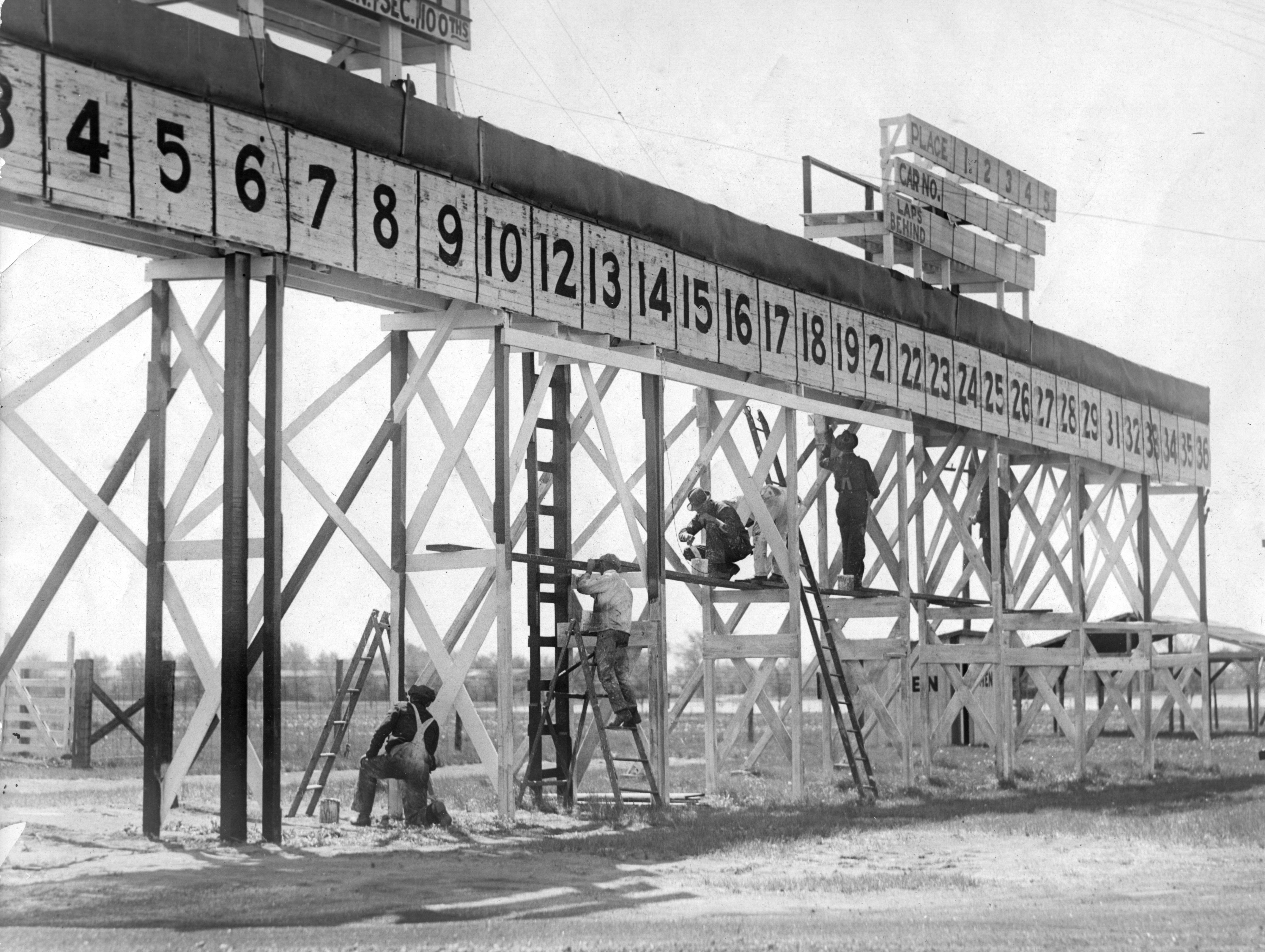 A crew of painters at the Indianapolis Motor Speedway brightened up the scoreboard behind the pits with a new coat of paint prior to the 1929 race.