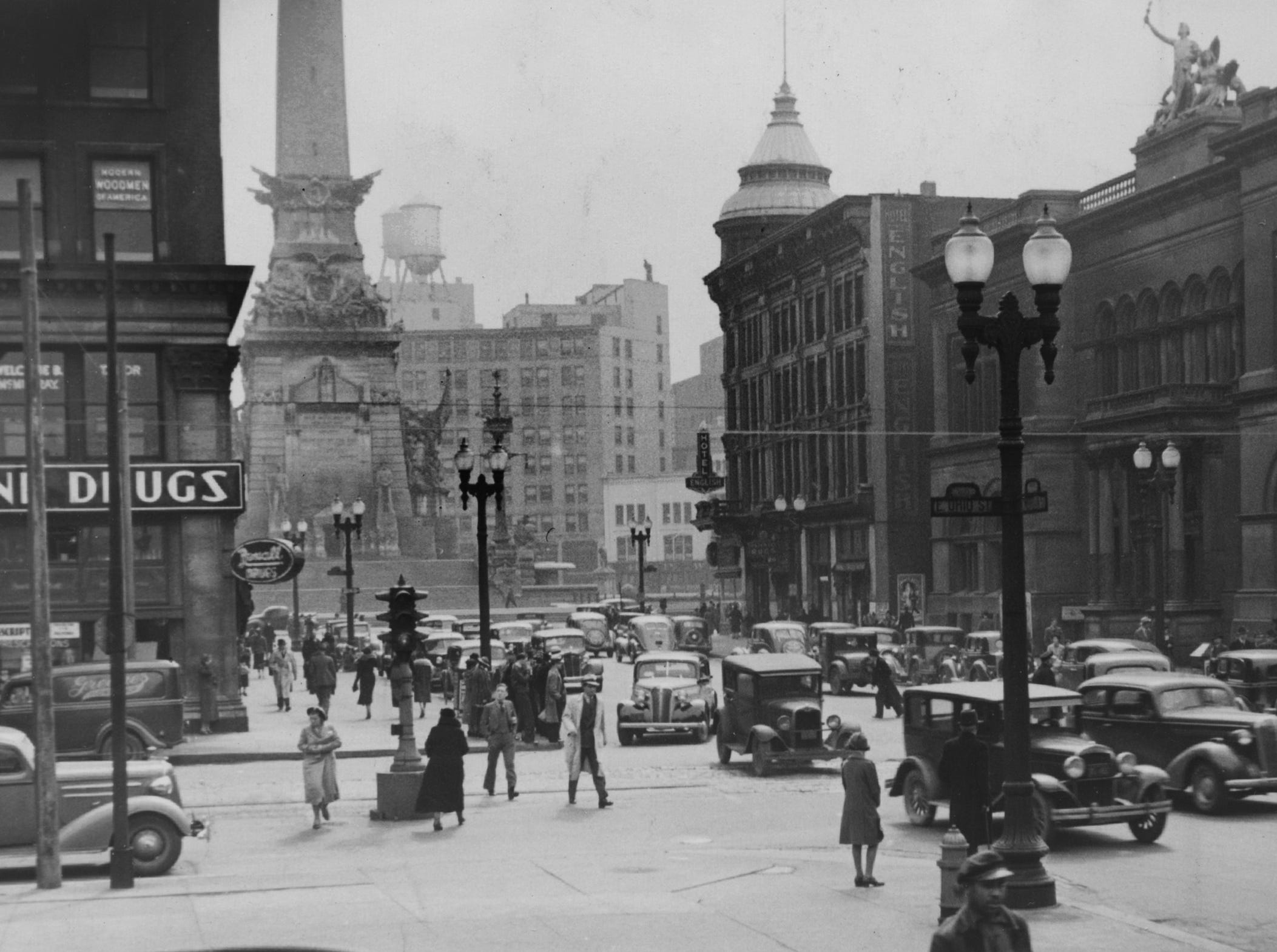 1925 file photo looking south at the corner of Ohio and Meridian Streets. Keene Drugs is to the left. The Soldiers and Sailors Monument and the English Hotel and Opera House at the corner of the circle and Meridian Street.  The building to the far right is the Board of Education and the Public Library.