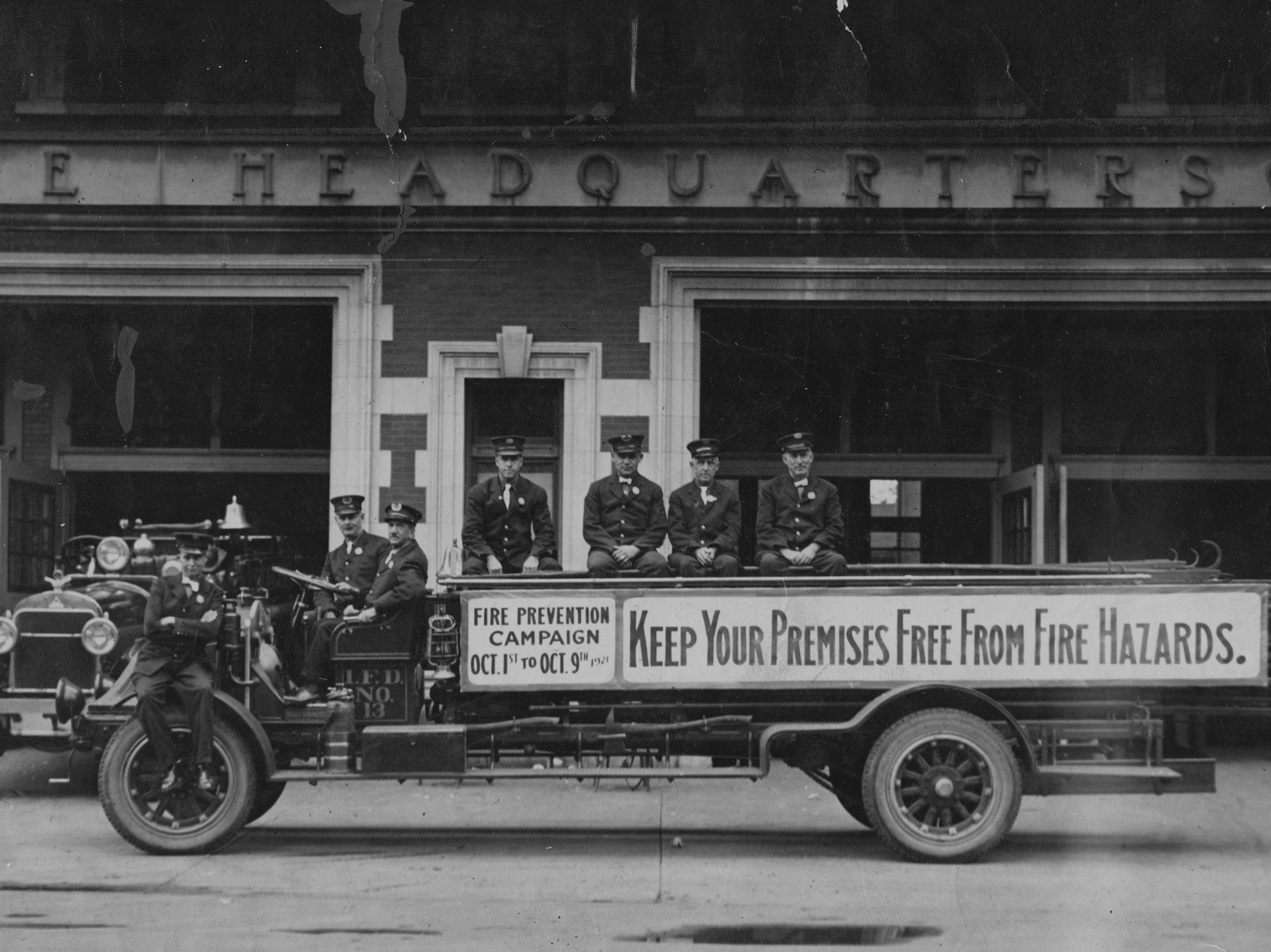 Indianapolis Fire Dept. members during a fire prevention campaign in 1922.  The members are on IFD No. 13, Ladder 7 1915 Kelly/Springfield service truck.