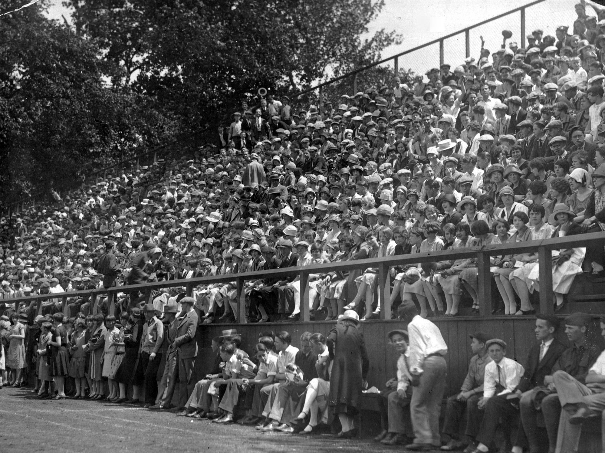 A track meet in 1926 attracted large crowds to Arsenal Technical High School. Opened in 1912 (officially designated as the city's third high school in 1916) as a manual and technical training school, it expanded its curriculum during the 1920s and, by 1930, had 242 teachers and 6,000 students. State track meets were held at Tech beginning in 1922, but the meets moved to Butler University in 1937.