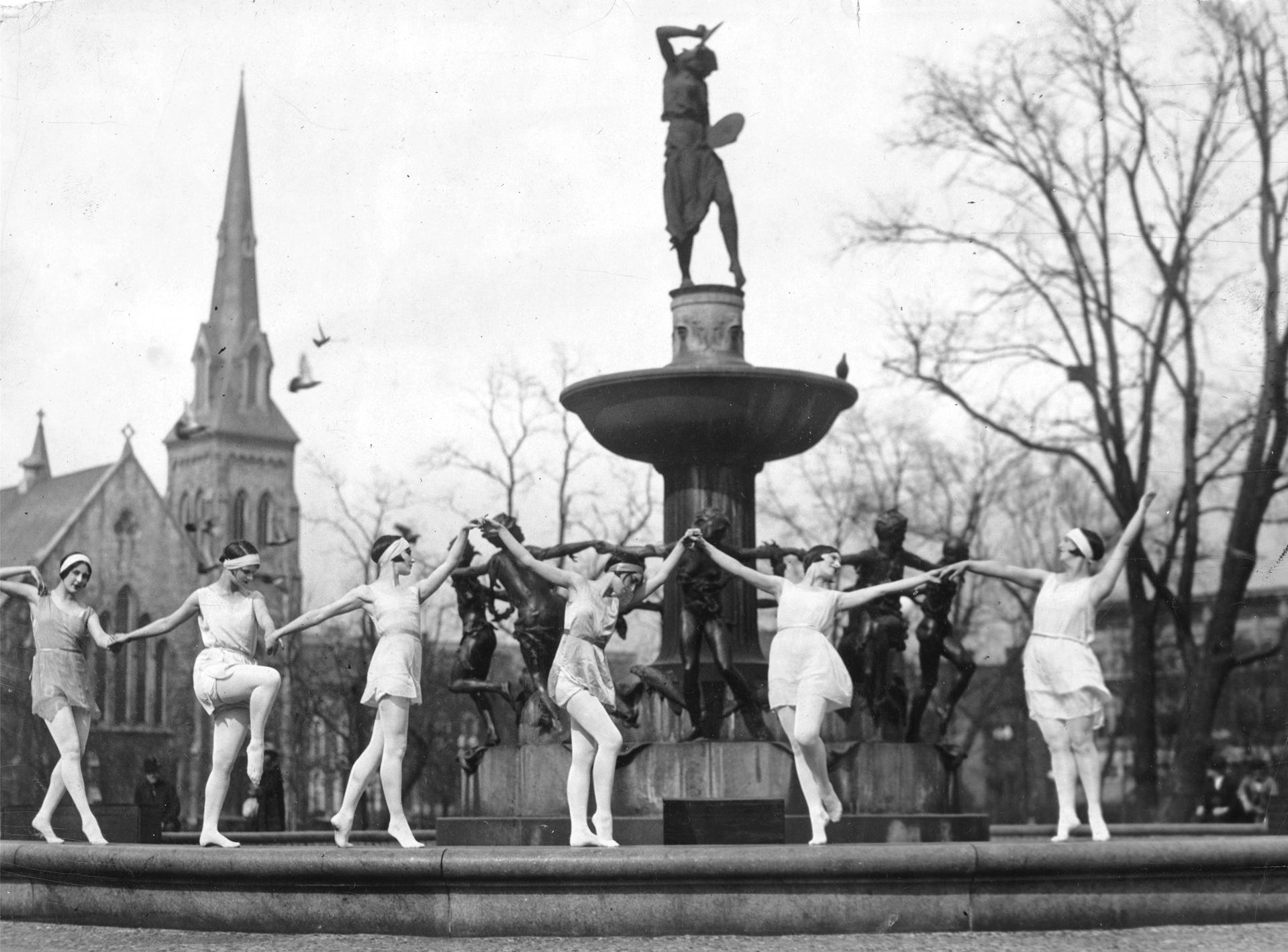 Young women did interpretive dancing around the Depew Memorial Fountain in University Park on April 21, 1926, marking the 10th anniversary of the fountain. Gardeners in the park dropped their trowels and dozens of heads popped into view in windows at the north side of the old Federal Building to observe. The dancers were members of the Albertina Rasch ballet appearing at Keith's Theater that week.