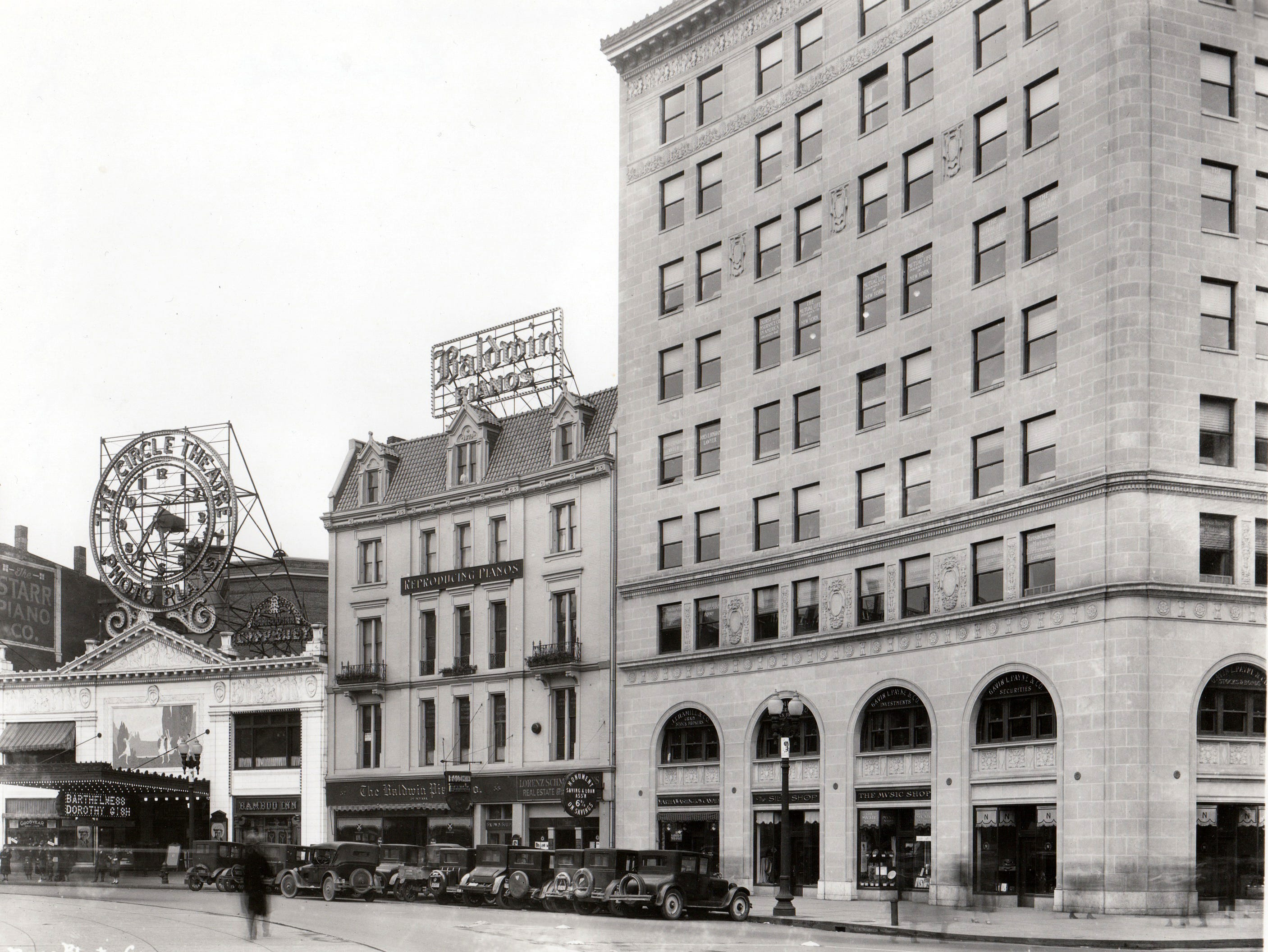"The Circle Theatre presented Richard Barthelmess and Dorothy Gish in the 1925 movie ""The Beautiful City"".  The Bamboo Inn was housed in a small corner of the theater. Baldwin Pianos to the right of the theater and the Continental Bank Building which was built in 1923. - the building now houses IPL."