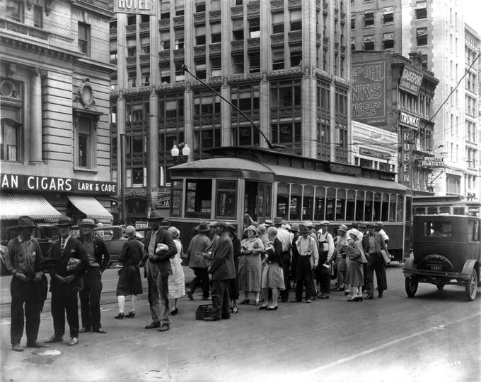 The W. Michigan trolley along Washington Street at the intersection of Illinois in the 1920s.