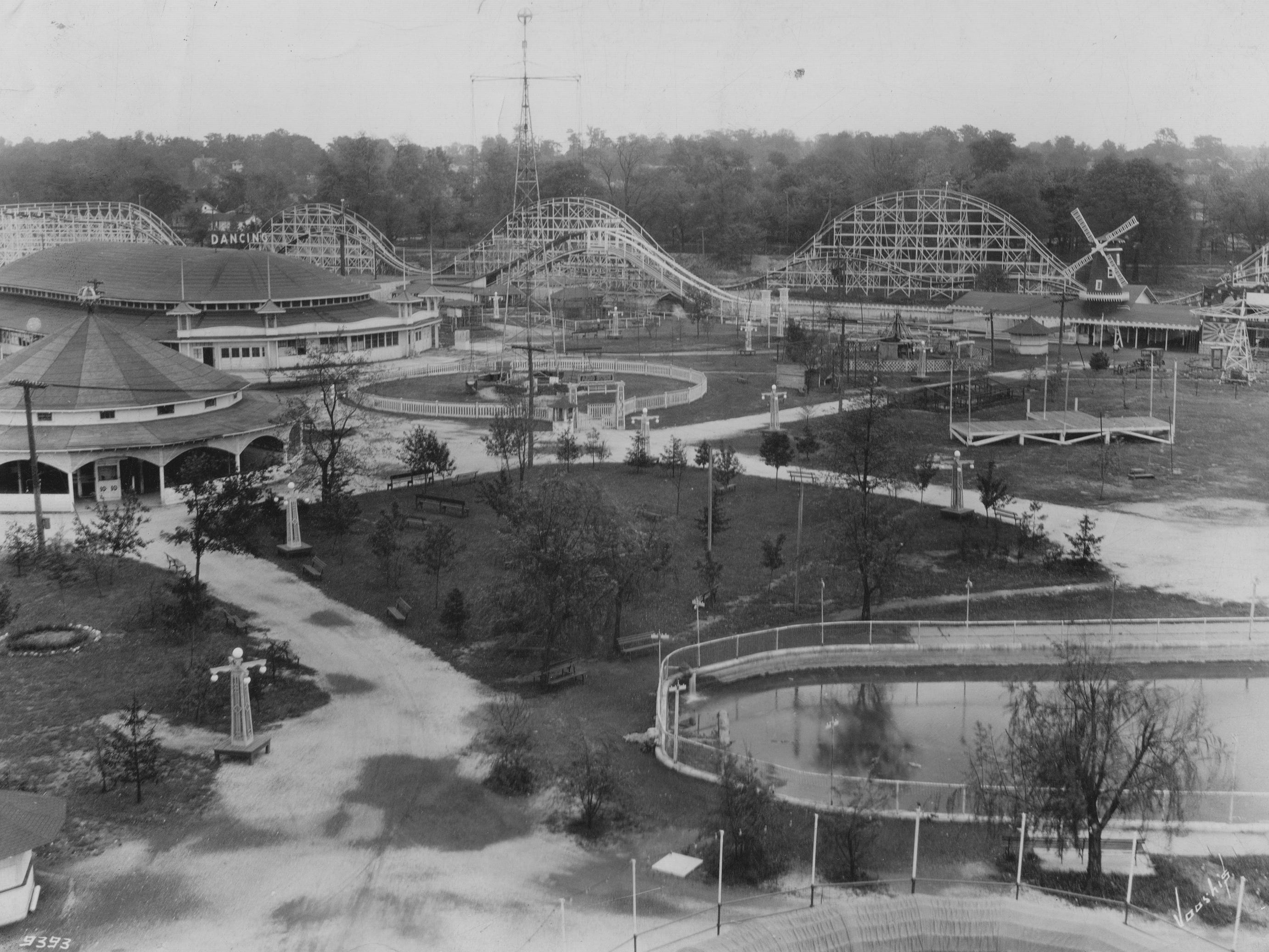 1928 Indianapolis Star file photo of Riverside Amusement Park.  The carousel to the left with the roller rink behind it (also served as the dance hall)  The roller coaster and the aerial swing  and the Dutch windmill.
