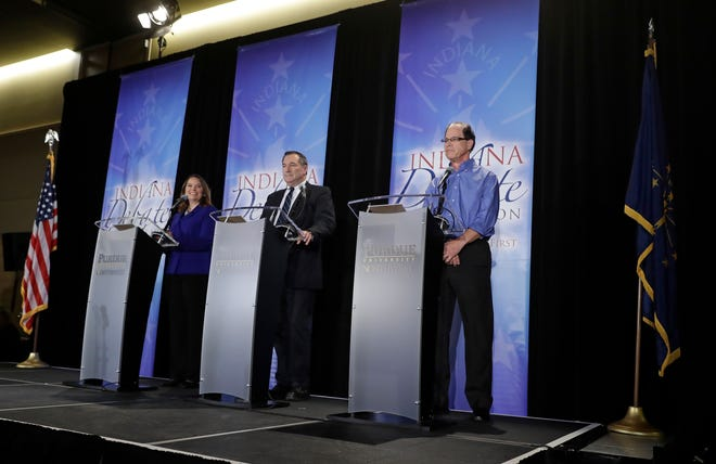 Libertarian Lucy Brenton, from left, Democratic Sen. Joe Donnelly and Republican former state Rep. Mike Braun participate in a U.S. Senate Debate, Monday, Oct. 8, 2018, in Westville, Ind.
