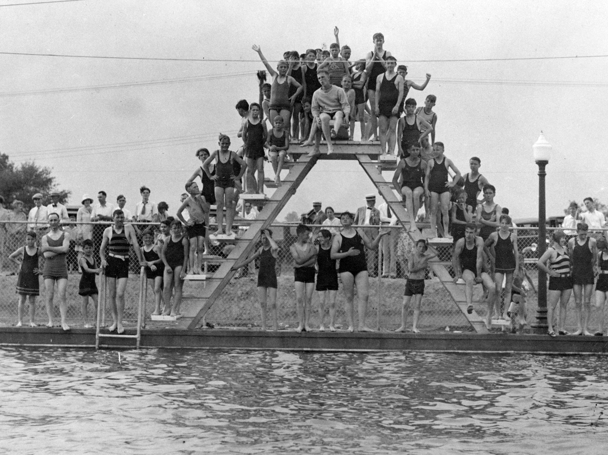 Swimmers pose on the diving platform of the Ellenberger Park swimming pool in 1929.
