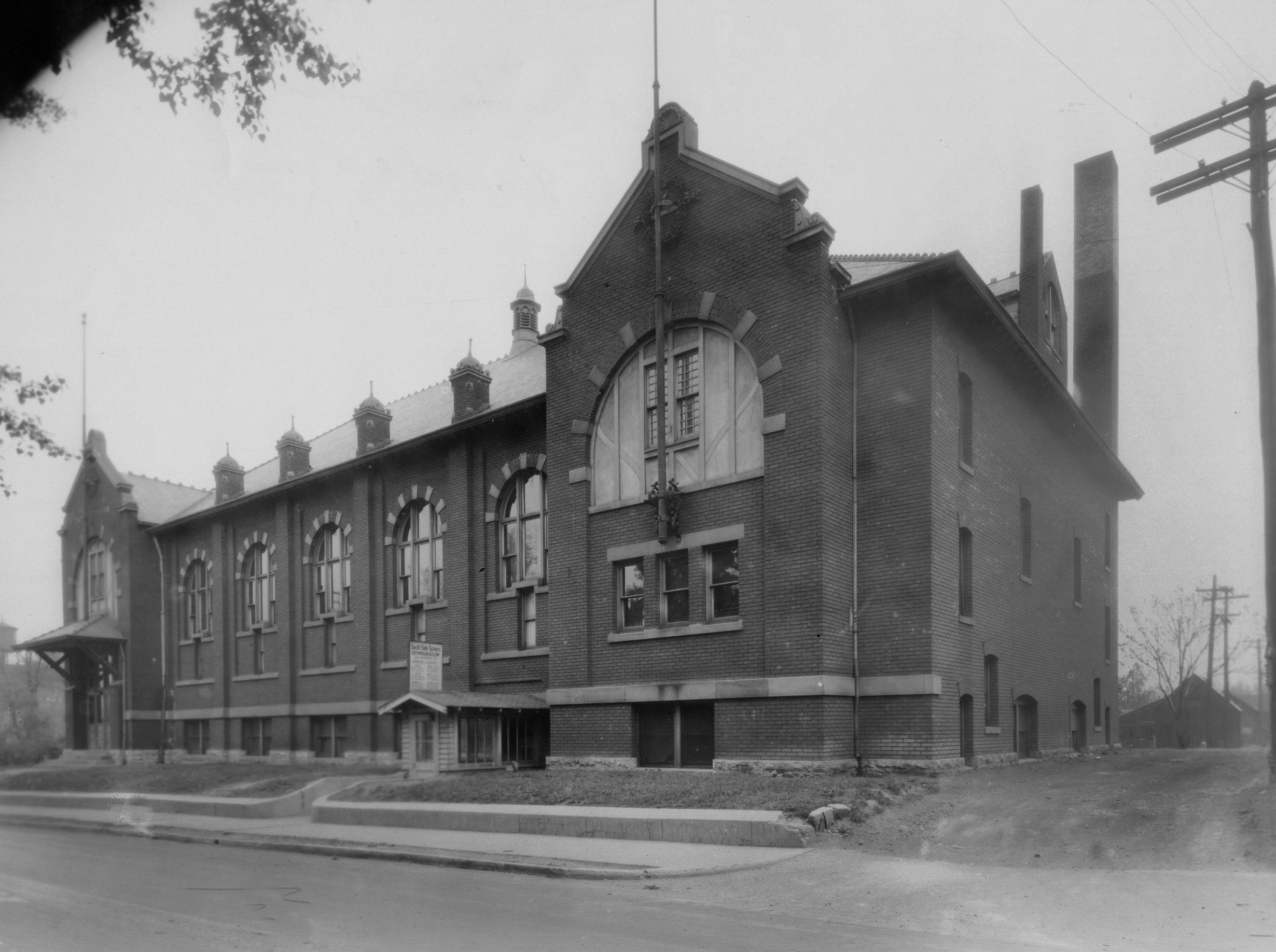 Southside Turners building at 306 Prospect Street, January 4, 1929.  It opened in 1900 as an athletic club and closed in 1975. It features a gym on the upper floor. By 1976 it had no roof and all the windows were broken out. Tony Elrod and Rob Mercer renovated the building and it reopened in 1978 as the Madison Avenue Athletic Club, hosting amateur basketball games.
