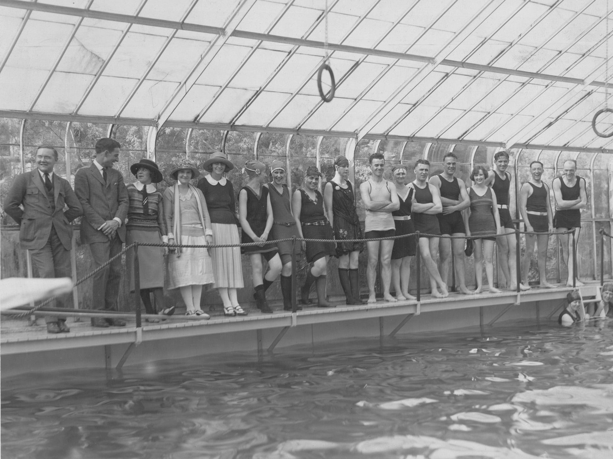Party-goers at the home of Carl and Jane Fisher line the deck of the FishersÕ glassed-in swimming pool in the summer of 1922. Jane Fisher spent afternoons between the hours of 3 and 6 oÕclock at home in her pool, Òa rendezvous for friends,Ó according to a news feature on popular swimming spots in Indianapolis. The snow-white basin filled with clear, cool water Òfairly magnetizes onlookers into diving in,Ó said the story.