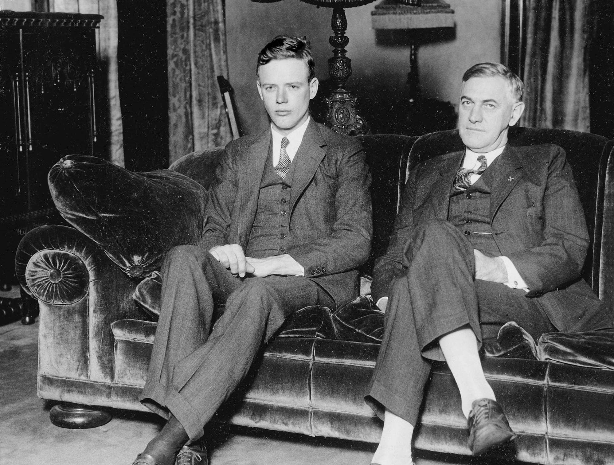 Aviator Charles A. Lindbergh (left), who in 1927 became the first man to fly solo across the Atlantic Ocean, paid an unexpected visit to Indianapolis on Thursday, Jan. 17, 1929. He dropped by the GovernorÕs Mansion on Fall Creek Boulevard to congratulate Indiana Gov. Harry G. Leslie, who took office just three days prior. Lindbergh, 26, arrived in town on Wednesday afternoon, spent the night at the Lincoln Hotel, then arose at 5 a.m. on Thursday. From then until shortly after 9 a.m., he walked unescorted and unnoticed along Downtown streets, enshrouded in heavy fog. Lindbergh was making a cross-country inspection  of proposed airports on a coast-to-coast 24-hour air-rail service that was to be inaugurated April 1 of that year. One of those airports was IndianapolisÕ Mars Hill airport, which was to be used temporarily as a stopping point for the new service.