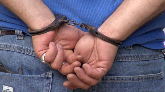 A suspect is handcuffed after a standoff in Lee County.
