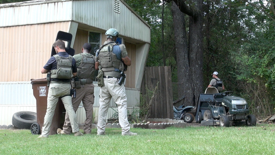 U.S. Marshals task force members stage around a home where a standoff took place during the Northern District's execution of Operation Triple Beam, Aug. 13 to Sept. 14, 2018.