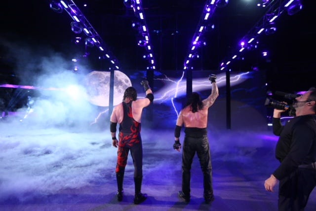 Knox County Mayor Glenn Jacobs appears as Kane at the WWE Super Show-Down at the Melbourne Cricket Ground in Australia on Oct. 6, 2018.