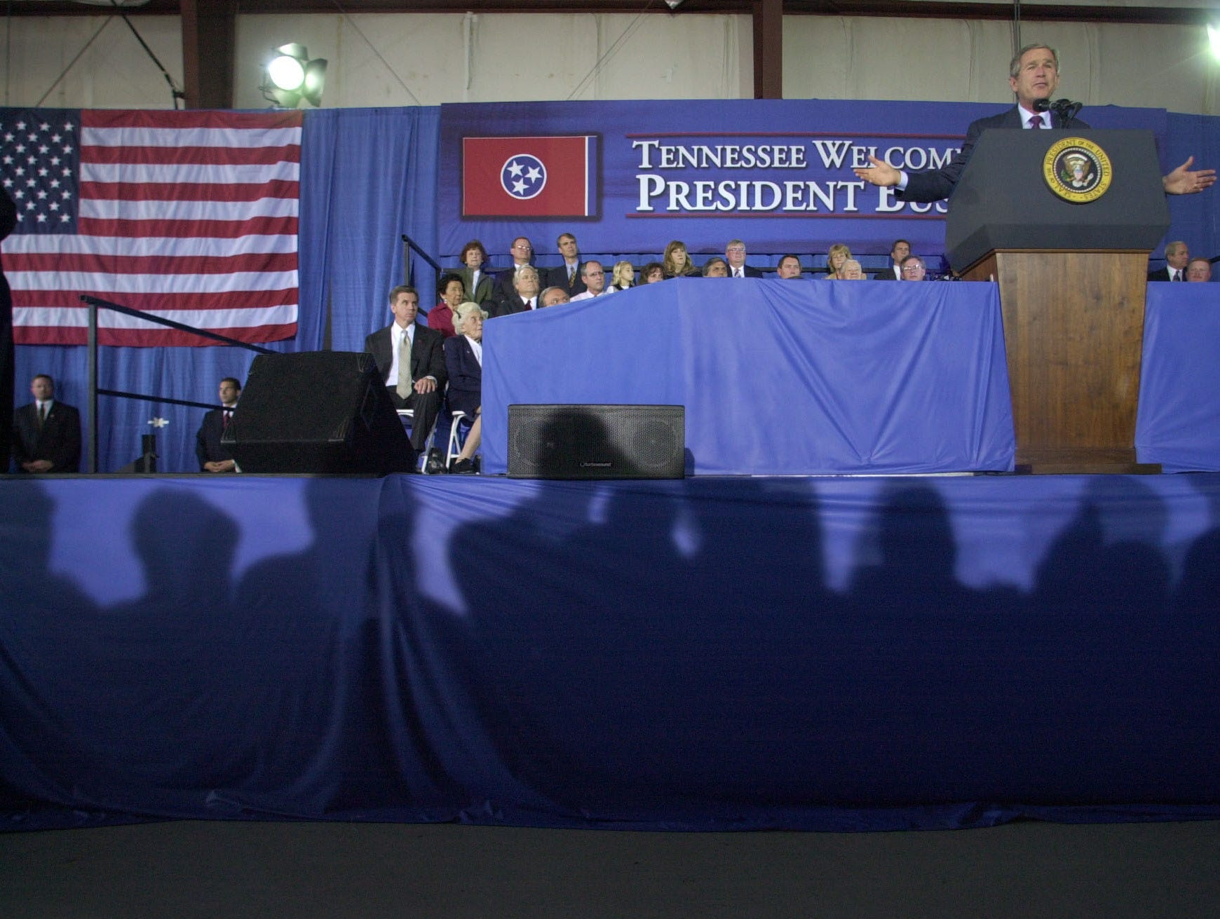 President George W. Bush addresses the crowd Tuesday, Oct., 8, 2002 at the Cherokee Aviation Hangar in Alcoa, Tenn. during a visit. Bush then travels to Knoxville where he will attend the Van Hilleary for Governor Luncheon at the Knoxville Convention Center. 2002