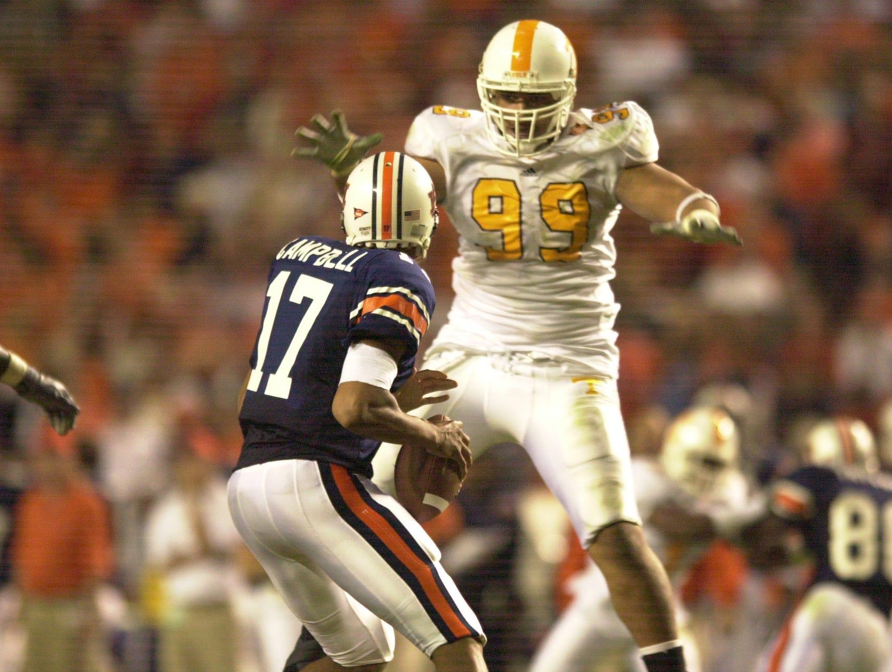 Tennessee's J.T. Mapu pressures Auburn quarterback Jason Campbell on Saturday at Auburn.