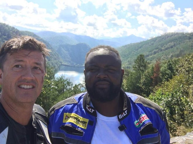 "Tony Lohning (left) and Henry Turner Jr. pose for a photo during a visit to the stretch of U.S. Highway 129 known as ""The Dragon."""