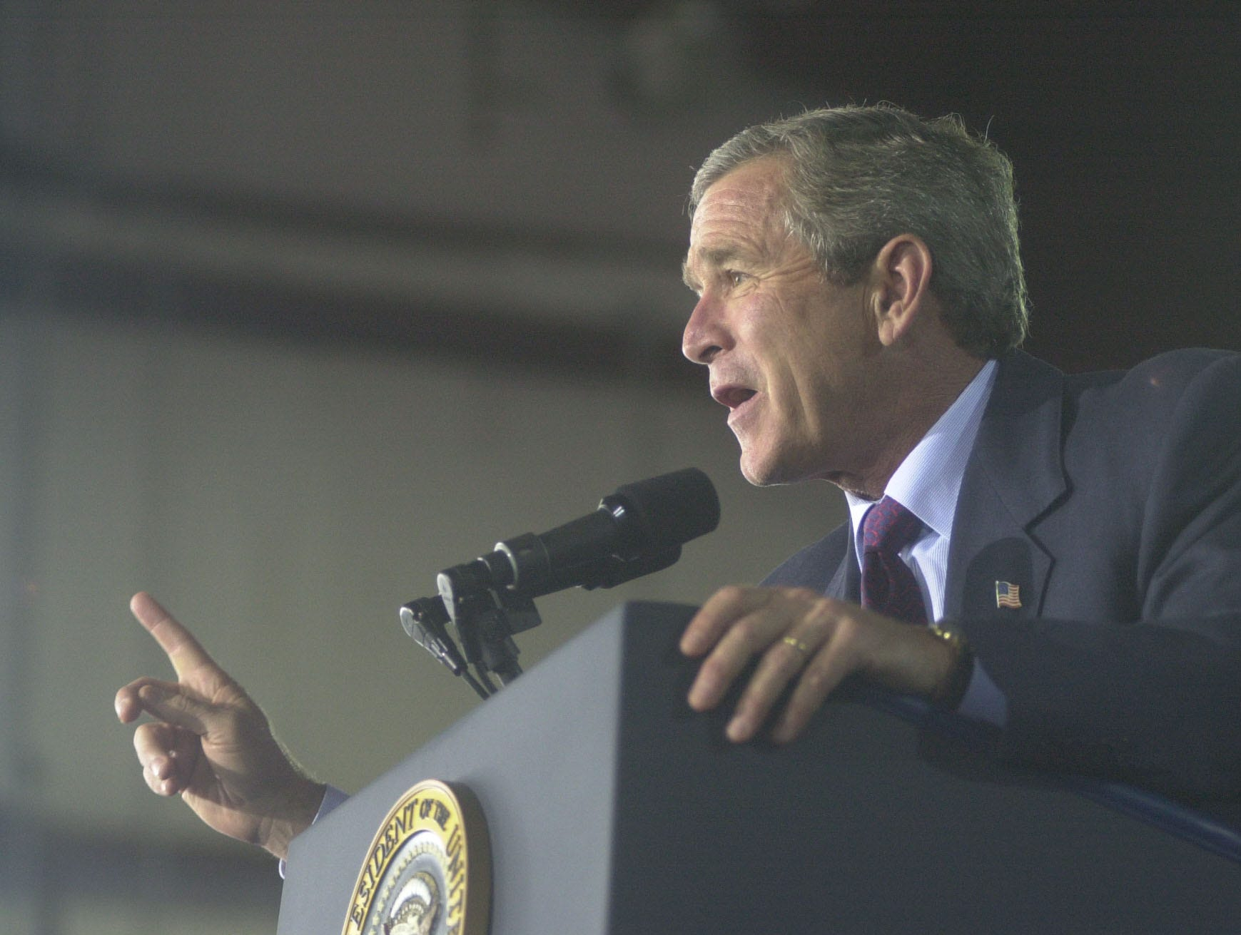 President George W. Bush addresses the crowd Tuesday, Oct., 8, 2002 at the Cherokee Aviation Hangar in Alcoa, Tenn. during a visit. Bush then travels to Knoxville where he will attend the Van Hilleary for Governor Luncheon at the Knoxville Convention Center. 2002 News-Sentinel photo by Saul Young